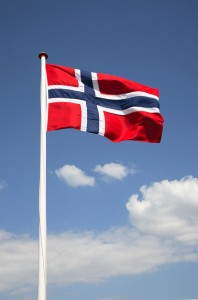 The Norwegian flag against a blue sky.